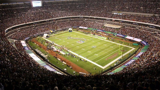 "In this Oct. 2, 2005, file photo, Azteca Stadium in Mexico City, Mexico is shown prior to the start of a regular season NFL game between the Arizona Cardinals and San Francisco 49ers. Eleven years after the network telecast an NFL game from Mexico City, it will do so again when the Raiders ""host"" the Texans on Monday night."