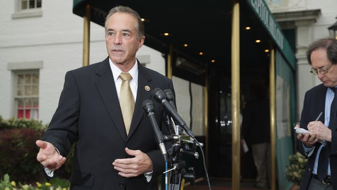 Rep. Chris Collins, R-N.Y., talks to reporters on Capitol Hill on April 21, 2016.