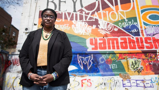 Marlanda Dekine, executive director of Speaking Down Barriers, stands by a mural in Spartanburg, SC on Wednesday, March 22, 2017. #weareonenation
