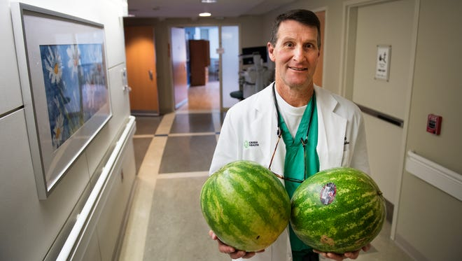 Dr. Larry Puls compared a patient's 52-pound tumor to the size of four watermelons.