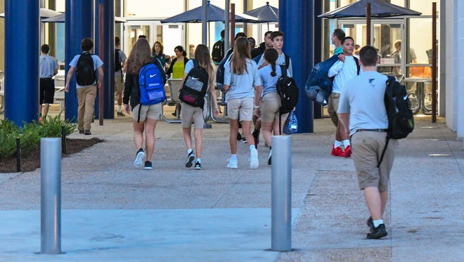 Students arrive at Southside High in Youngsville in 2017. A former substitute teacher for the school claims she witnessed abuse against special education students at the school and has since been blocked from working for the district since reporting the alleged abuse.