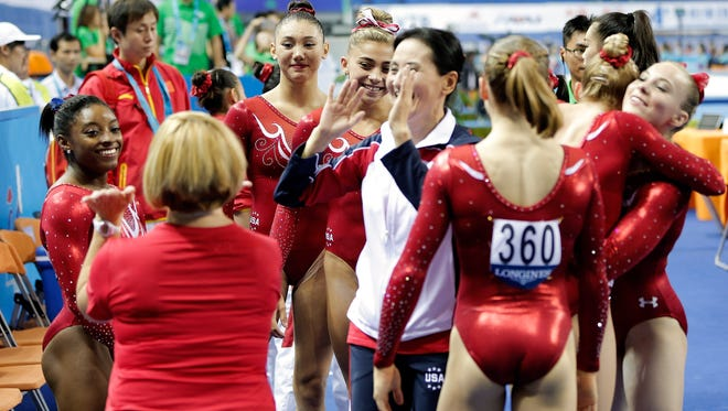 The United States women's team celebrates after winning the gold medal the world championships in Nanning, China.