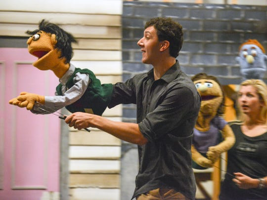 Sam Balzac and his puppet, Princeton, rehearse for