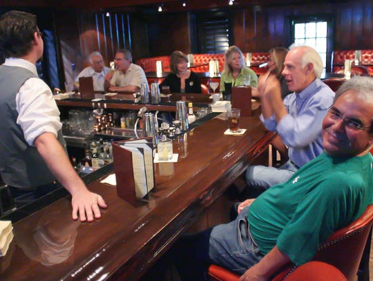 The Columbus Inn still has the walnut, horseshoe-shaped bar that regulars have been visiting for 65 years.
