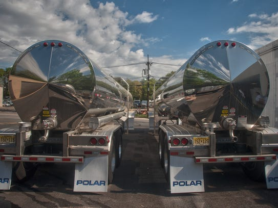 Trailer tank trucks  filled with salt-water are shown