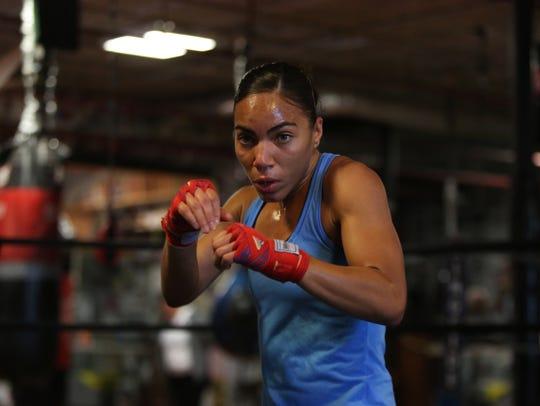 Professional boxer Natalie Gonzalez, 26, shadow boxes
