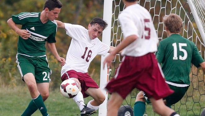 Archmere's Liam Delaney (left) tries to score past St. Elizabeth's Ben Bryan late in the second half of Archmere's 2-1 win at Alapocas Run State Park Tuesday.