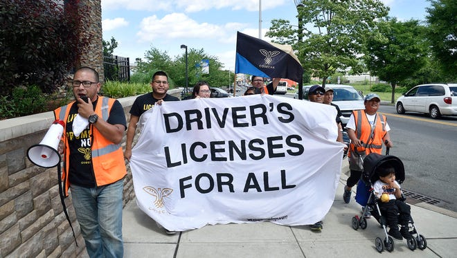 Advocates supporting a bill that would extend driving privileges to undocumented immigrants living in New Jersey marched through Newark on June 4, 2018.