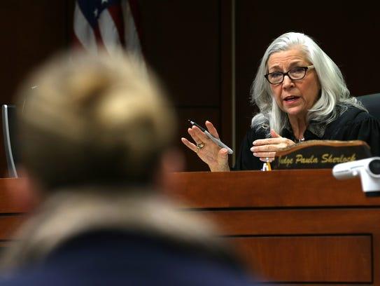 Family court judge Paula F. Sherlock talks with a parent