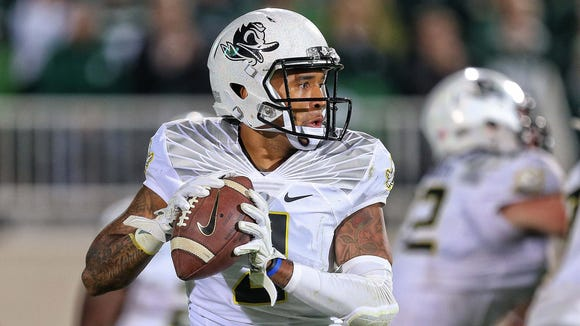 Sep 12, 2015; East Lansing, MI, USA; Oregon Ducks quarterback Vernon Adams Jr. (3) attempts to throw the ball against the Michigan State Spartans during the 2nd half of a game at Spartan Stadium. MSU won 31-28. Mandatory Credit: Mike Carter-USA TODAY Sports