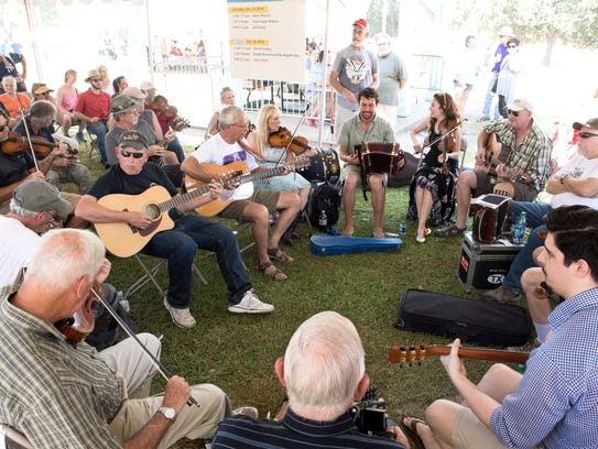 Musicians gather for a jam session at Festivals Acadiens