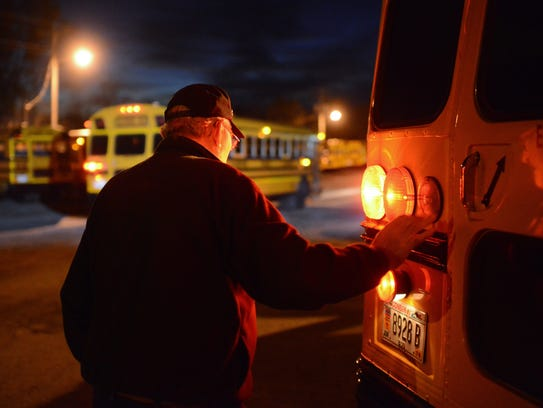 Lamers bus driver Earl Habeck completes an inspection