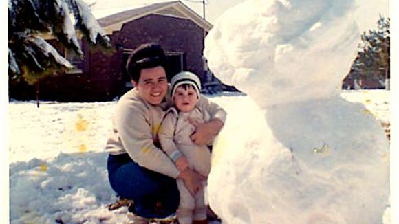 Mama and me with snowman  she, Pops and I  worked on in 1968.