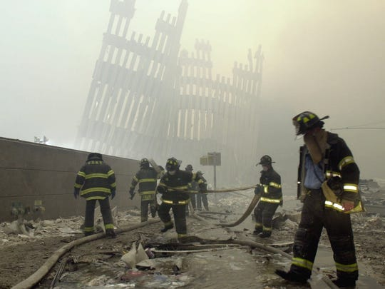 With the skeleton of the World Trade Center in the