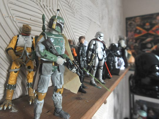 Some of Thorn Fairchild's action figures sit on a shelf.