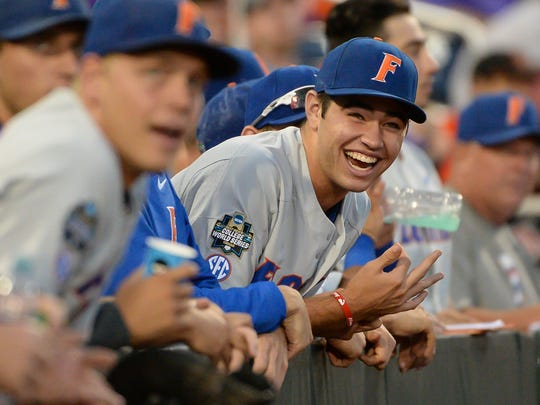 Florida Gators pitcher Cole Maye reacts to a play in