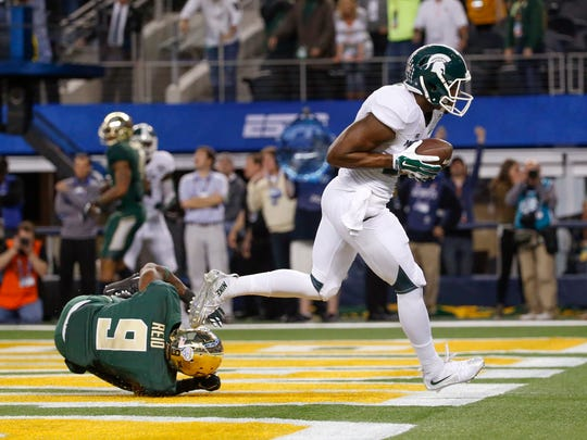 MSU wide receiver Keith Mumphery (25) scores the Cotton Bowl Classic-winning touchdown in front of Baylor's Ryan Reid (9) on Jan. 1.
