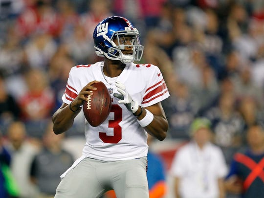 New York Giants quarterback Geno Smith (3) drops back to pass against the New England Patriots during the first quarter at Gillette Stadium.