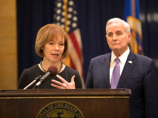 Minnesota Gov. Mark Dayton listens to Lt. Gov. Tina Smith as she was named to replace fellow Democrat Al Franken in the U.S. Senate on Wednesday, Dec. 13, in St. Paul, Minn.   Franken announced his resignation last week amid growing sexual misconduct allegations.
