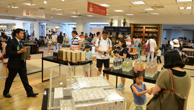 Customers look at merchandise at Lotte Duty Free's retail space at A.B. Won Pat Guam International Airport in this 2013 file photo. The Korea-based company took over the airport concession area in July 2013 after the airport ended its decades-long retail concession agreement with DFS Guam. DFS Guam sued the A.B. Won Pat Guam International Airport Authority on April 11 for alleged violations of the Open Government Law and the Sunshine Reform Act of 1999.