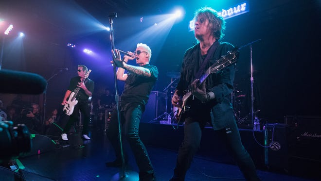 Robert DeLeo, Jeff Gutt, and Dean DeLeo of Stone Temple Pilots performs onstage during SiriusXM Presents Stone Temple Pilots Live from the Troubadour on November 14, 2017 in Los Angeles, California.