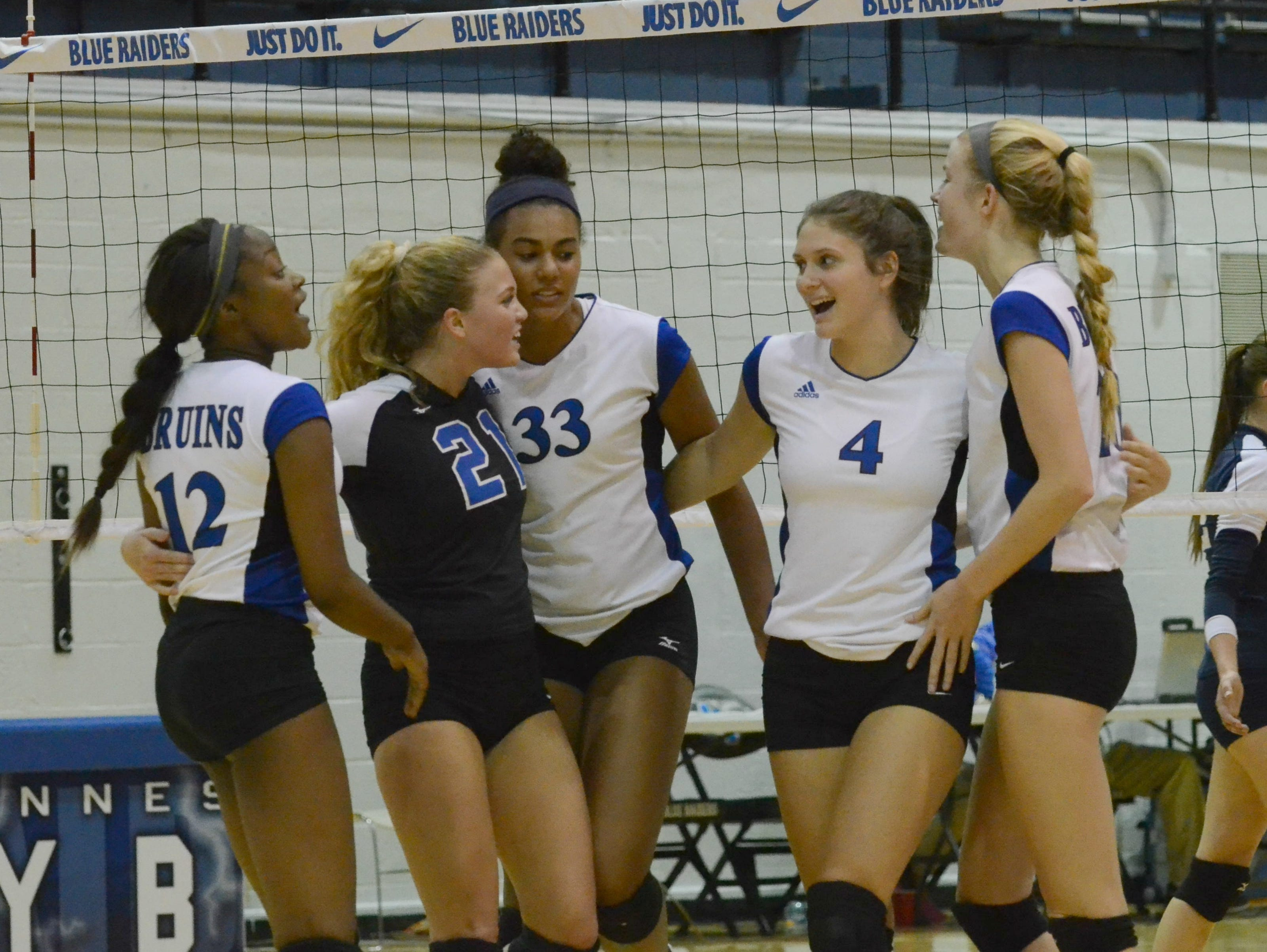 The Brentwood Lady Bruins celebrating after scoring a point during Wednesday evening's Class AAA winner's bracket semifinal against Farragut.