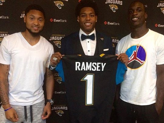 Former Seminoles Rashad Greene, Jalen Ramsey and Telvin Smith pose for a photo during Ramsey's introductory conference with the Jacksonville Jaguars on April 30, 2016.