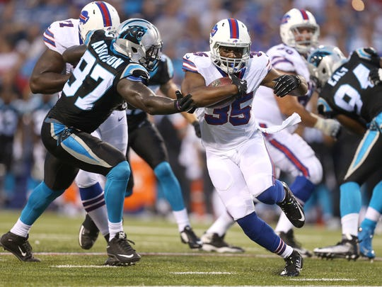 Bills running back Bryce Brown cuts back against Carolina's Mario Addison (97).