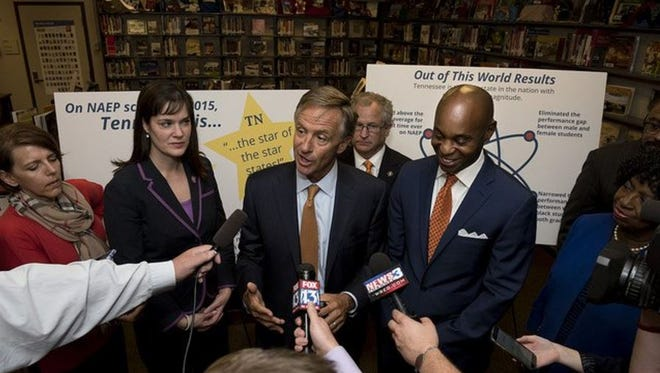 Education Commissioner Candice McQueen and Shelby County Schools Superintendent Dorsey Hopson flank Gov. Bill Haslam at a 2016 event in Memphis. This week, McQueen sided against Hopson's administration in its battle with a charter operator over the sharing of student information.
