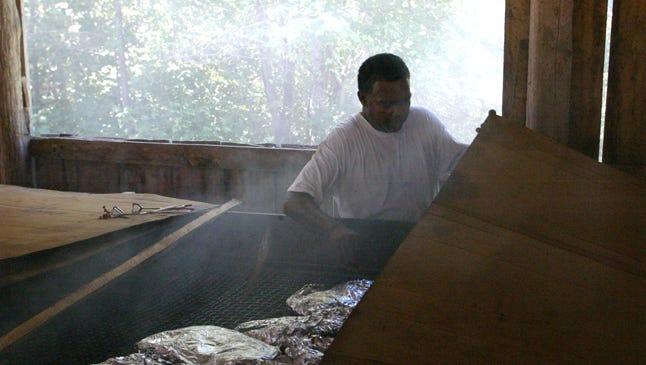 Cornelius Thomas tends the barbecue at the 2010 Charlotte Picnic.