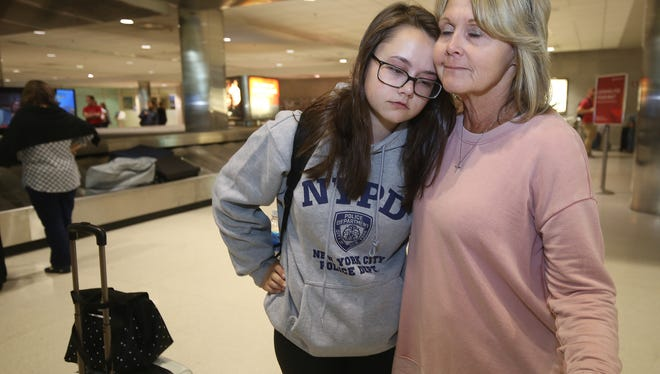 Madysen Noskowiak, 18, gets a hug from her mother Lisa Noskowiak of Brighton at the baggage claim area of Detroit Metro Airport Monday Oct. 2, 2017. The women were at the outdoor concert festival last night in Las Vegas where a shooter sprayed the crowd with gunfire.