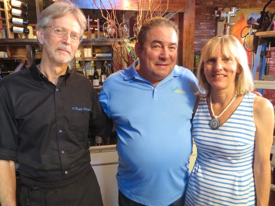 "Chef Emeril Lagasse featured 11 Maple Street on his Cooking Channel show ""Emeril's Florida."" Lagasse (center) is pictured with restaurant owners  Mike and Margie Perrin."
