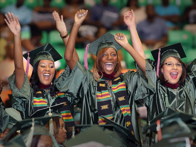 FAMU graduates whoop it up after moving their tassles on Friday. Hundreds of FAMU graduates earned their diplomas and took their official walk during Friday's Commencement Exercises inside the Lawson Center.