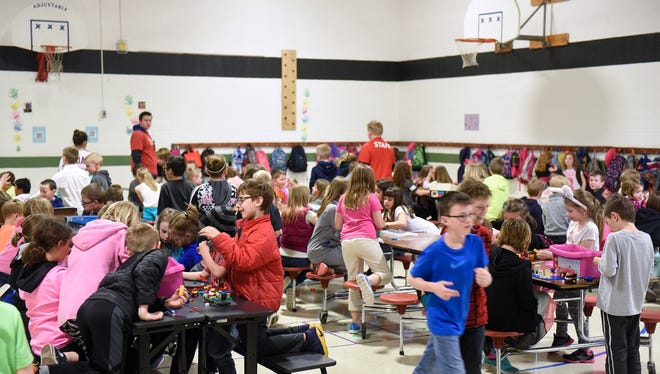 Students fill the gymnasium space for KIDSTOP activities after school in this April, 2017 photograph taken at Pleasantview Elementary School in Sauk Rapids.
