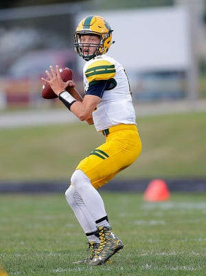 Ashwaubenon senior quarterback Ryan Johnson, shown in a game at Green Bay Preble on Aug. 26, led his team to a 63-56 victory over Green Bay Southwest on Friday.
