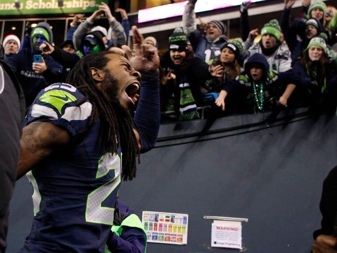Seattle Seahawks cornerback Richard Sherman (25) celebrates following a 34-7 Seattle victory against the New Orleans Saints at CenturyLink Field.
