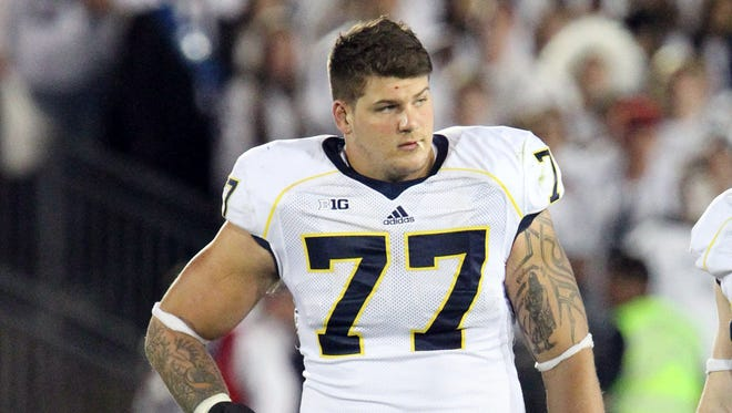 Michigan offensive lineman, a top NFL prospect, on Wednesday denied accusations he engaged in an assault on Michigan's campus Nov. 30.