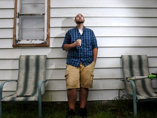 Ben Kollock survived Leukemia without the use of medicinal marijuana, despite doctors telling him it could have helped ease his suffering. Now, he's been a social advocate in the Stevens Point area, having lived through the condition. He is photographed outside his home in Stevens Point, Wisconsin, September 22, 2016.