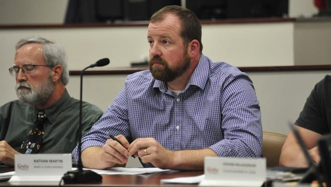 Nathan Martin, a councilman in Shelby, listens to concerned residents Monday night.