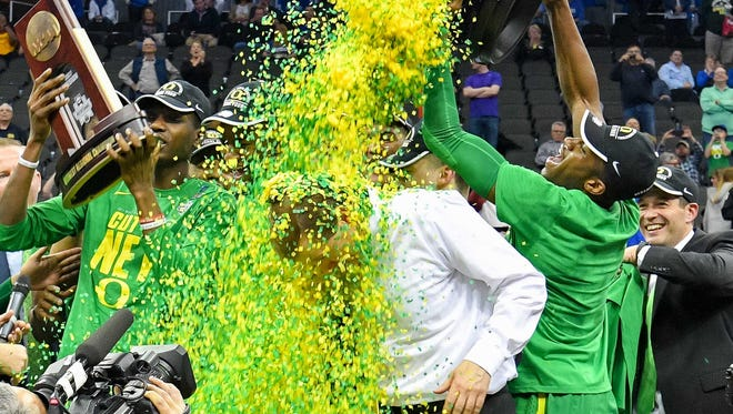 The Oregon Ducks douse coach Dana Altman is with confetti as they celebrate their Midwest Regional final win over the Kansas Jayhawks in the 2017 NCAA Tournament.