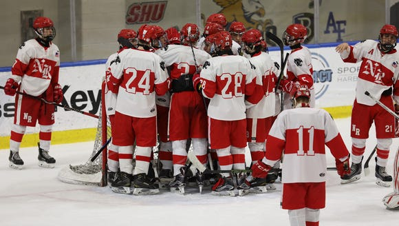 North Rockland surrounds goalie Angelo Zodda following