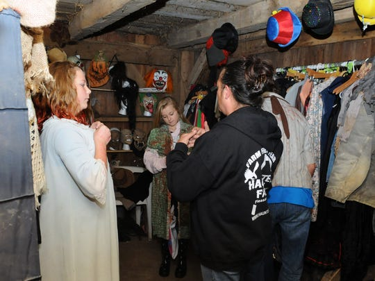 Kim Hicks, center, helps cast members find outfits Friday at the Haunted Farm in Pleasantville.