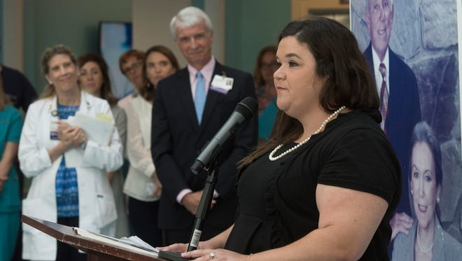 Jane Lauter, granddaughter of Jack and Jane Kugelman, speaks after the Kugelman Foundation donated $250,000 to the Studer Family Children's Hospital at Sacred Heart during a ceremony at the hospital on Thursday, May 24, 2018.