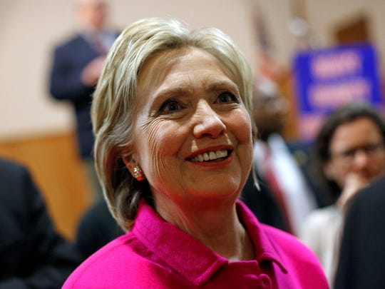 Democratic presidential candidate Hillary Clinton greets attendees after speaking at the Scott County Democrats Red, White and Blue Banquet in Davenport, Iowa, Saturday, Jan. 23, 2016. (AP Photo/Patrick Semansky)