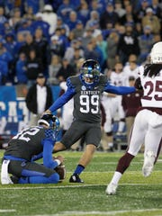 Oct 22, 2016; Lexington, KY, USA; Kentucky Wildcats kicker Austin MacGinnis (99) kicks the game winning field goal against the Mississippi State Bulldogs in the second half at Commonwealth Stadium. Kentucky defeated Mississippi 40-38.