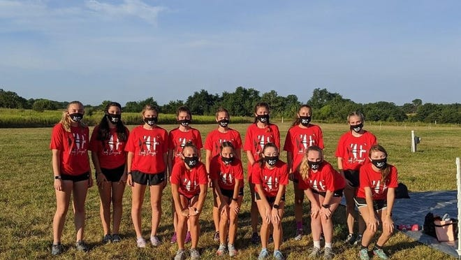 The Pekin girls cross country team gathers for a photo at Dunlap Valley Middle School. In front from left are Lauren Filarski, JayLynn Riley, Elizabeth Deverman, Gwen Sivori and Kinzie Kirgan. In back from left are Sienna Baker, Liberty Kasinger, Kylee Hadsall, Kylie Oyler, Jayvian Riley, Olivia Wolf, Lily Wagemann and Emma Cox.