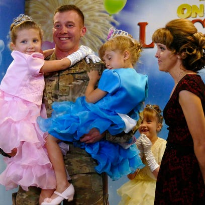 Air Force Sergeant Adam Hicks is shown with his children