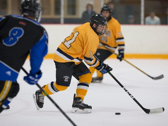 Stickhandling in the Oct. 15 game against Sault College