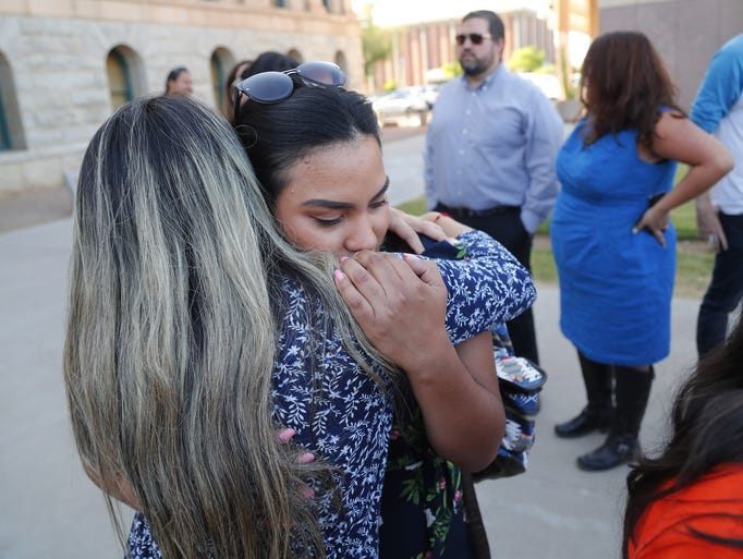 Norma Jimenez, right, is hugged by Liz Luna during
