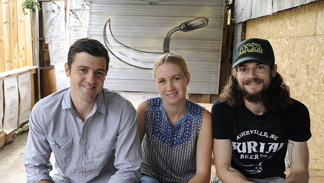 Burial Beer will have some new beers Thursday and Friday.  Pictured are owners  Doug Reiser, Jessica Reiser, and Tim Gormley.